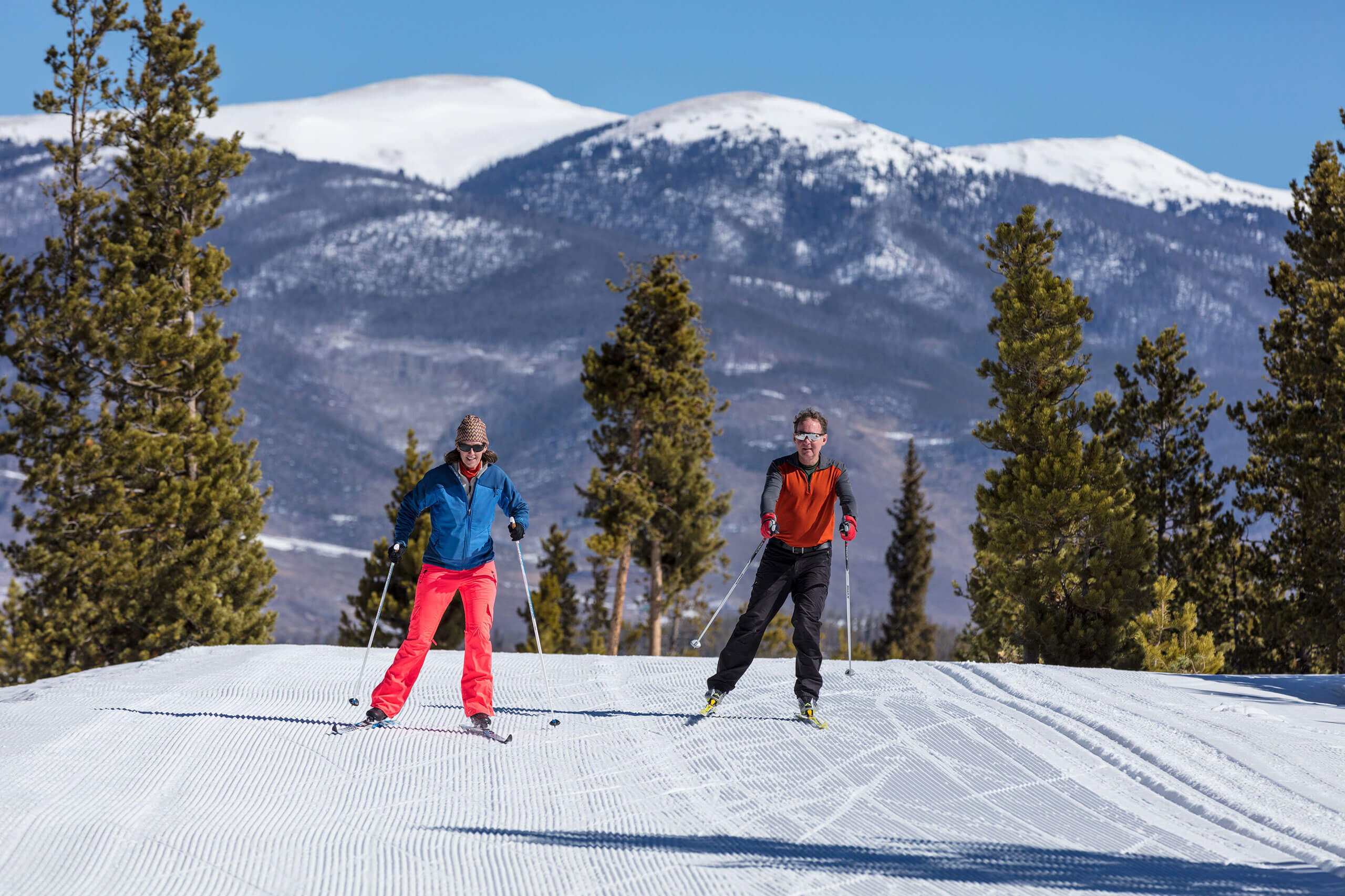 A couple skate skiing at the Frisco Nordic Center.