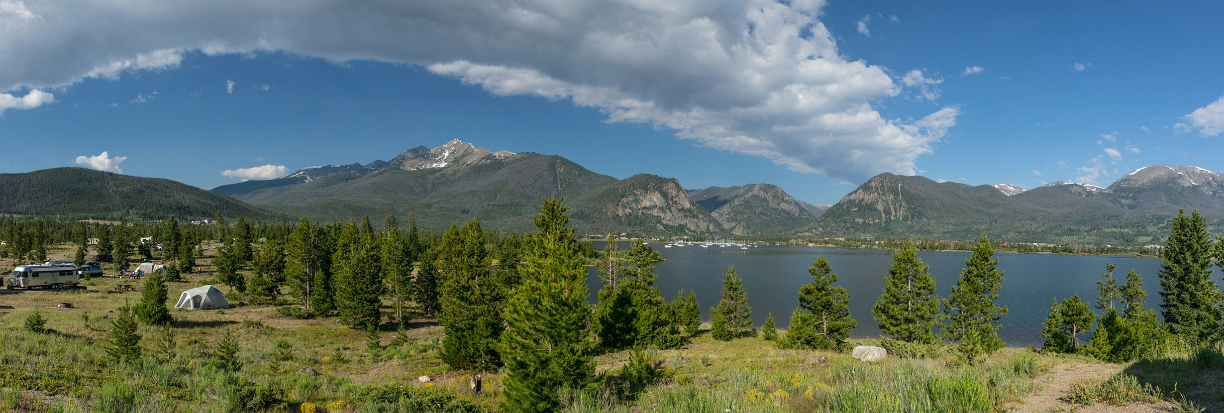 Panoramic view of a campground, Lake Dillon, and the Tenmile Range.
