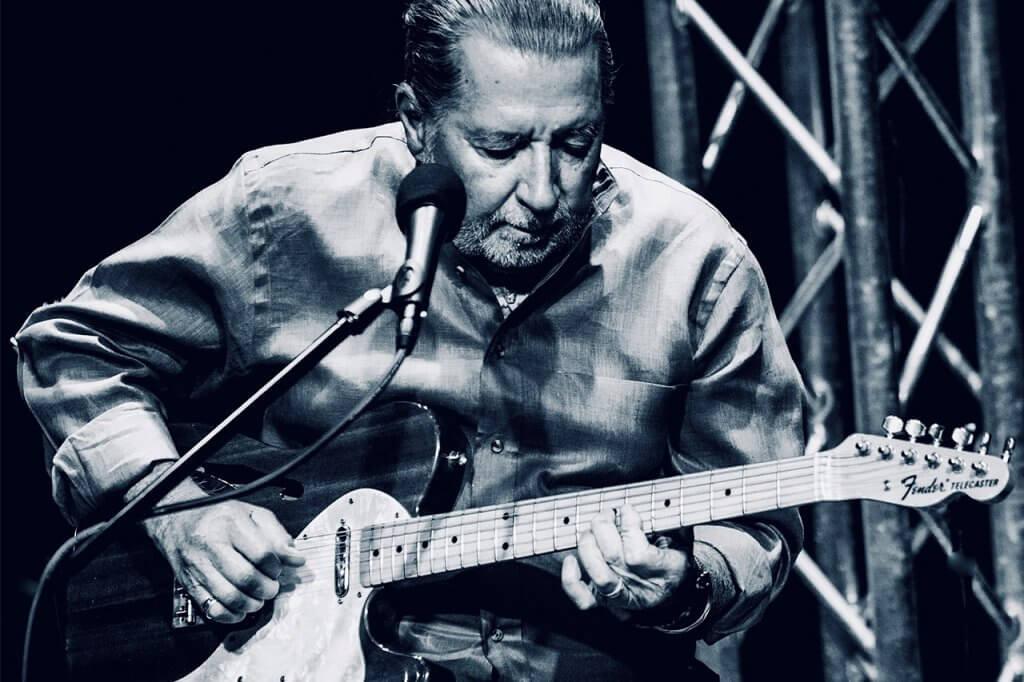 Leon Joseph Littlebird playing guitar