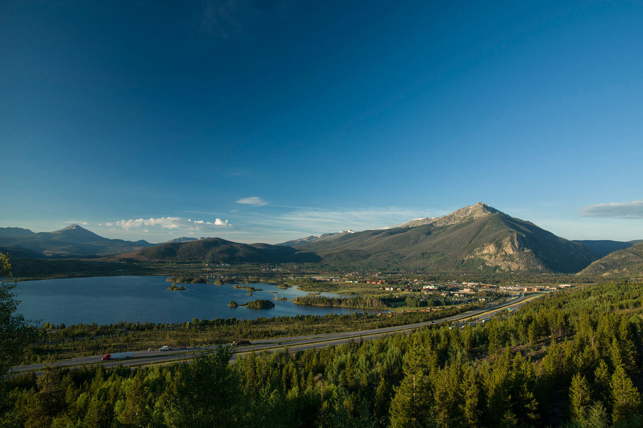 Scenic picture of I-70, Lake Dillon, and Peak One on a sunny day.
