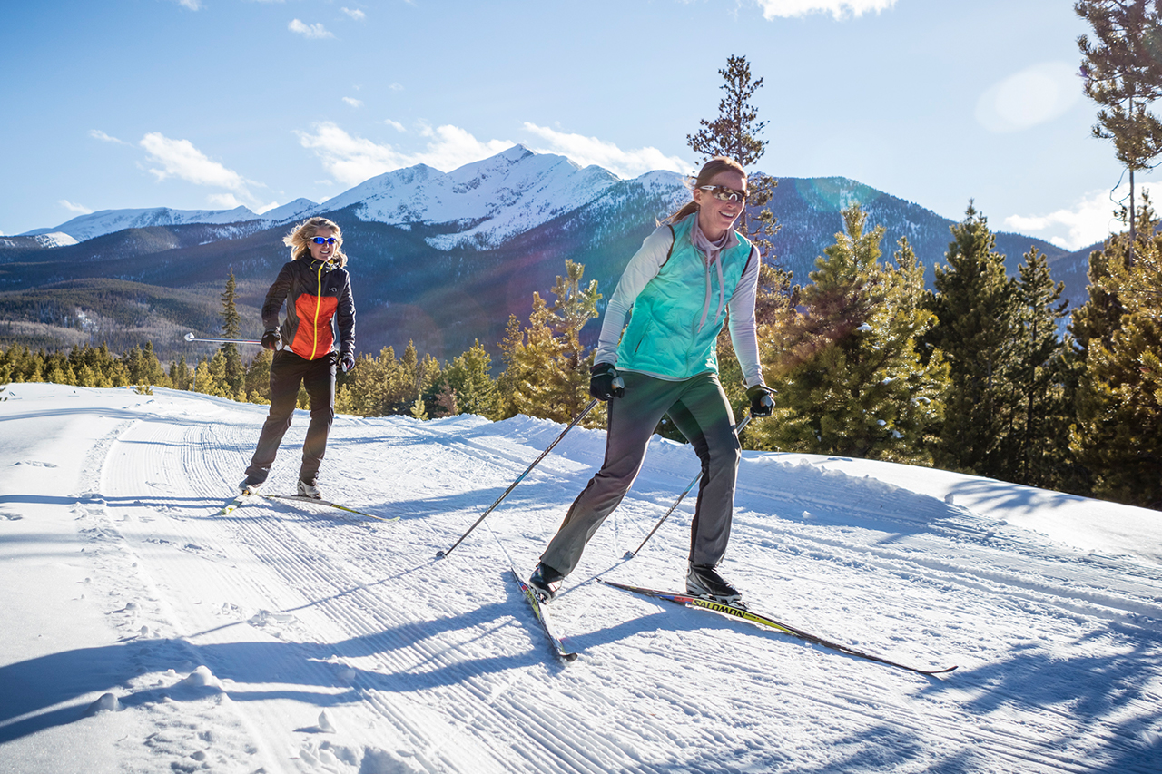 Two women skate skiing at the Frisco Nordic Center.