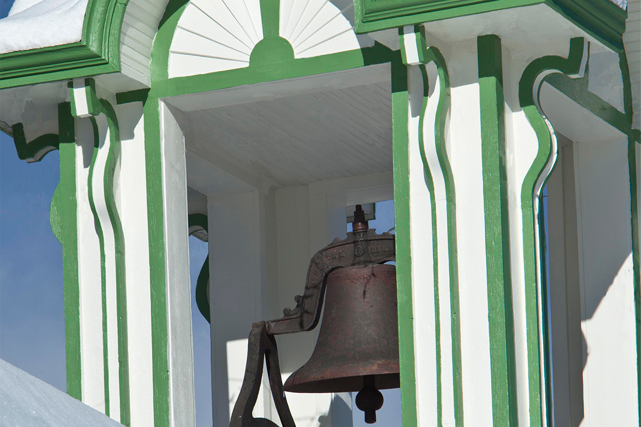 Close up shot of historic bell on Schoolhouse Museum at Frisco Historic Park