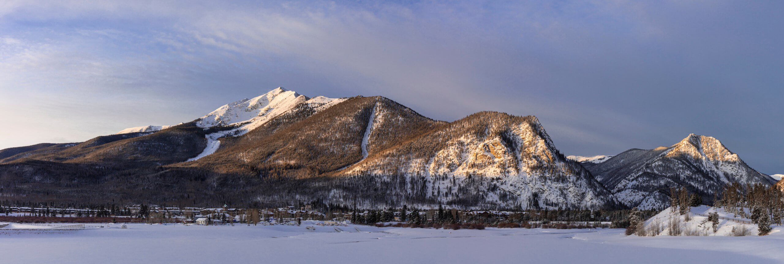 View of Mountain Royal and Peak One from Dillon Reservoir in winter